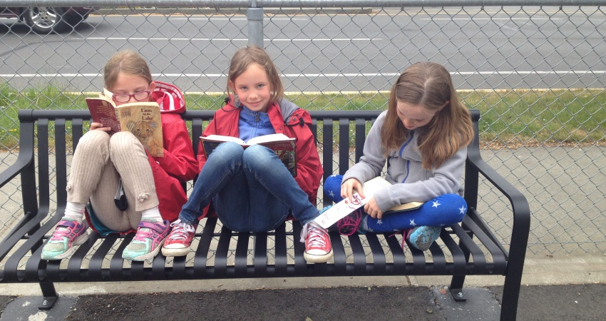 Students enjoy a book on our new benches